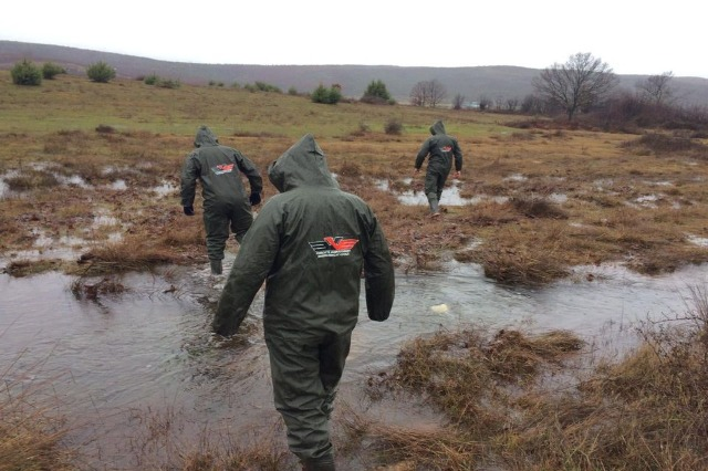 Albanian Armed Forces deployed in terrain, assisting the citizens in need