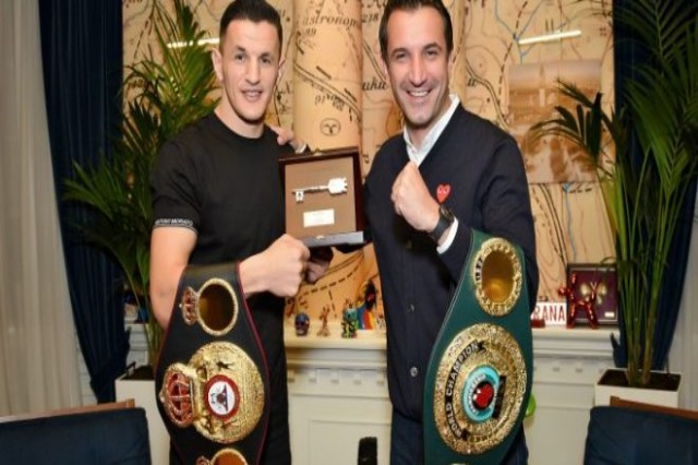 "The Mayor of Tirana, Erion Veliaj, hands the ""Key of the City"" to the newly declared Albanian world boxer, Robin Krasniqi"